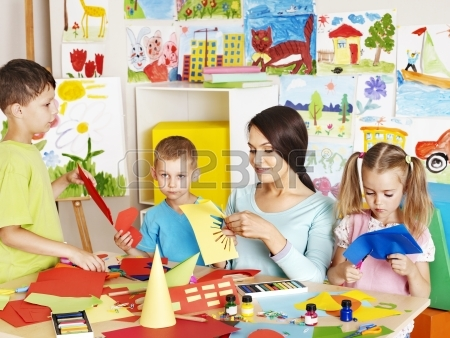 20724439-happy-children-with-scissors-at-classroom