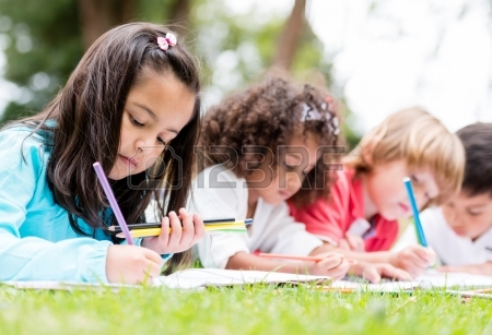 21788266-happy-group-of-children-coloring-at-the-park